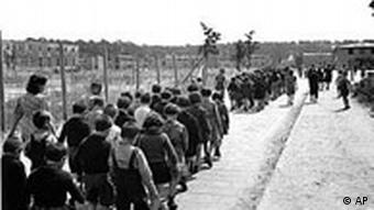 Children walking to a camp for displaced persons in Berlin