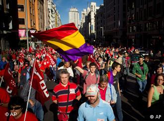 A demonstrator waves a Spanish Republican flag (1931 to 1939) during a march on Madrid's Gran Via, on Wednesday, Sept. 29, 2010. Spanish workers staged a general strike Wednesday to protest austerity measures imposed by a government struggling to slash its budget deficit and overcome recession. (AP Photo/Victor R. Caivano)