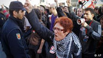 Protestors shout slogans against open stores on Madrid's Gran Via, on Wednesday, Sept. 29, 2010. Spanish workers staged a general strike Wednesday to protest austerity measures imposed by a government struggling to slash its budget deficit and overcome recession. (AP Photo/Victor R. Caivano)
