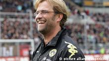 firo Fußball,Fussball, 25.09.2010 1. Bundesliga, Saison 2010/2011 FC St. Pauli - BVB, Borussia Dortmund 1:3 Jürgen Klopp, Trainer BVB, lacht