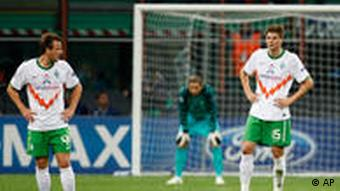 Bremen midfielder Philipp Bargfrede, left, Sebastian Prodl, of Austria, right, and goalkeeper Tim Wiese react after Inter Milan forward Samuel Eto'o, of Cameroon, scored during a Champions League, Group A, soccer match between Inter Milan and Werder Bremen at the San Siro stadium in Milan, Italy, Wednesday, Sept. 29, 2010.