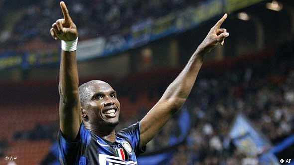 Eto'o with both arms raised in the air