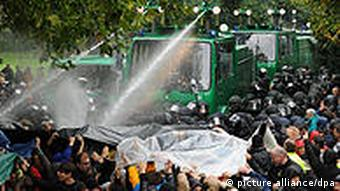 Truck with water cannon sprays protestors