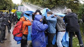 Police fire water cannons at protestors