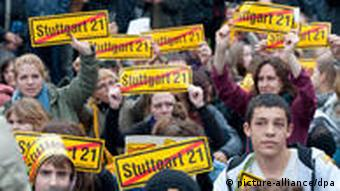 Protesters hold signs against Stuttgart 21