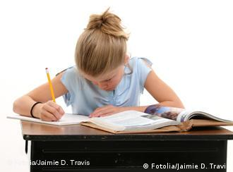 A girl doing schoolwork at a desk