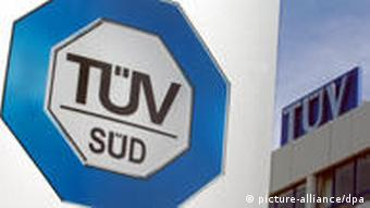 TUEV SUED's logo before one of its buildings