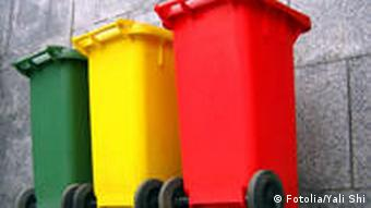 A green, a yellow and a red trash container