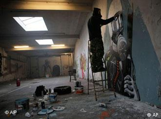 A squatter painting a mural