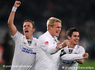 St. Pauli player Marius Ebbers, Max Kruse and Fin Bartels