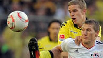 Bayern's Bastian Schweinsteiger, right, and Dortmund's Sven Bender challenge for the ball during the German first division Bundesliga soccer match between Borussia Dortmund and Bayern Munich in Dortmund, Germany, Sunday , Oct. 3, 2010.