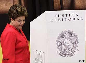 Brazil's President Luiz Inacio Lula da Silva, third left, raises his Chief of Staff Dilma Rousseff´s arm, second left