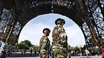 Police patrol at the Eiffel Tower