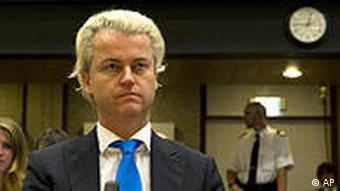 Dutch anti-Islam politician Geert Wilders, centre awaits the start of his trial