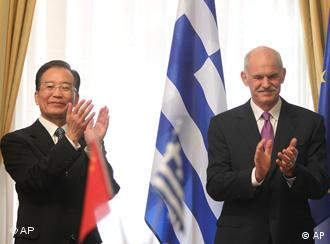 Greek Prime minister George Papandreou, right, and his Chinese counterpart Wen Jiabao , clap hands during the signing ceremony of 11 private business deals and two state cooperation agreements for trade and cultural affairs between the two countries in Athens, Saturday, Oct. 2, 2010. Chinese Premier Wen Jiabao vowed Saturday to double trade with Greece within five years, and to buy Greek bonds when the crisis-hit country returns to international markets. (AP Photo/Petros Giannakouris