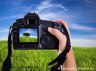 Фотограф снимает ландшафт