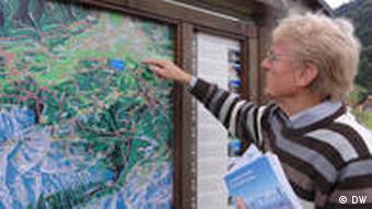 Andreas Keller points to a map of Garmisch