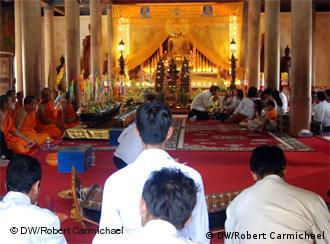A band plays as lay people and monks sit in the main pagoda building at Wat Langka in Phnom Penh
