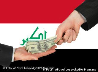 Dollars change hands in front of the Iraqi flag