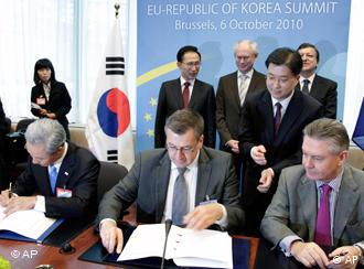 South Korean and EU representatives sign the Free Trade Agreement