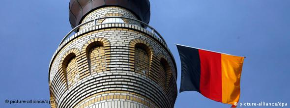 A German flag hanging from a minaret