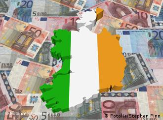 An outline of Ireland above a carpet of euro notes