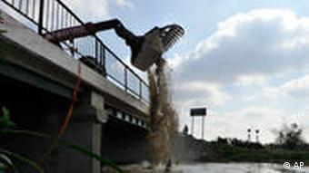 Plaster is being poured into the River Marcal to neutralize the polluting elements of its water