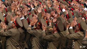 North Korean soldiers applaud to their leader Kim Jong Il after a massive military parade