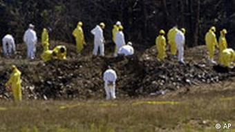 Federal Bureau of Investigation investigators comb the crater left by the crash Tuesday of United Airlines flight 93, a Boeing 757 in Shanksville, Pa., on Wednesday, Sept. 12, 2001. The plane crashed about 80 miles southeast of Pittsburgh after first flying near Cleveland and then turning around. The plane was said to be flying erratically and losing altitude. Analysts said recovery of Flight 93's cockpit voice recorder could be key in determining what happened. FBI assistant agent in charge Roland Corvington said that more than 200 investigators were on the scene and that the search might continue for three to five weeks.(AP Photo/Gene J. Puskar)