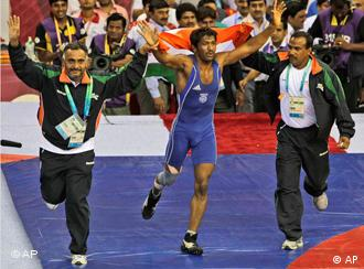 India's Yogeshwar Dutt celebrates his gold medal in the men's freestyle wrestling competition