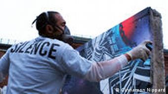 American aerosol artist, Chor Boogie, painting live at the Stroke.03 urban art fair in Berlin