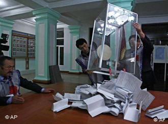 An Interior Ministry officer and members of a local electoral commission at a polling station