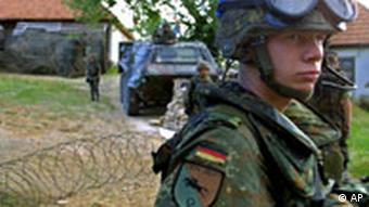 A German NATO-led soldier guards the entrance to a German peacekeepers camp in the Bosnian Serb village of Celebici