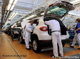 VW staff working in the factory in Wolfsburg on a Volkswagen Tiguan.