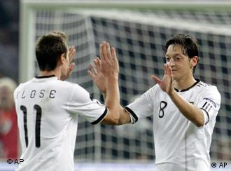 German football players Miroslav Klose and Mesut Oezil celebrate during the Soccer World Cup.
