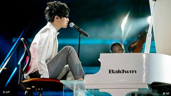Liu, who lost both arms in a childhood accident, won China's Got Talent performing his version of James Blunt's song You're Beautiful. The 23-year old Beijing native started playing the piano at 19. His first teacher quit because he thought it was impossible for someone to play with their toes.