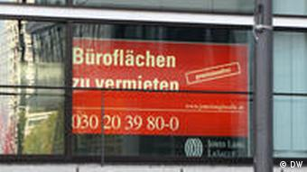 Billboard in a window of a building offering office space to rent