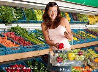 Woman buys fruit at supermarket