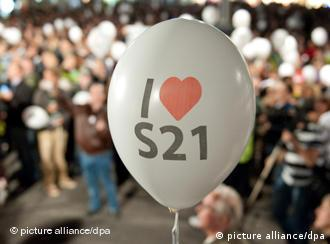 A white balloon with 'I heart S21 written on it