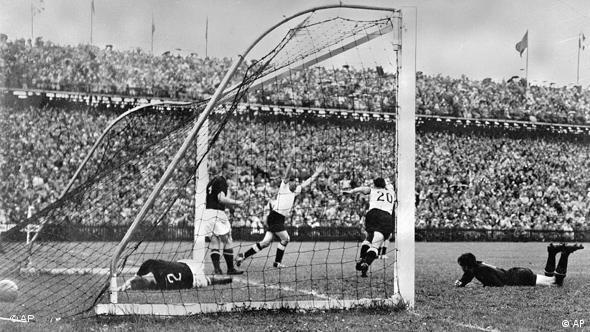 Helmut Rahn (with arms aloft) celebrates his equalizer