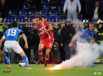 Fireworks on Italian football pitch