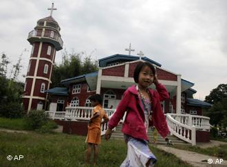 Children of the predominantly Christian Kachin minority outside a Catholic church in the town of Laiza