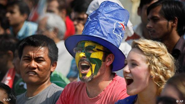 Australian fans cheer for their team, which beat India 8-0 in the men's hockey final