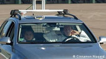 Dr Daniel Göhring sits in the driver's seat with his hands behind his head to show that he really isn't driving.