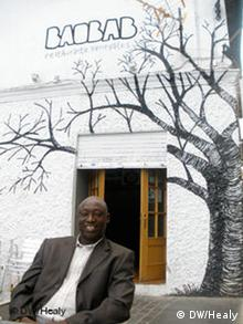Ibrahima Ndiaye outside his restaurant