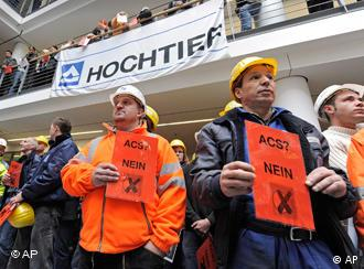 Hochtief employees protest against a hostile takeover by Spanish ACS during a visit of German Social Democrats (SPD) leader Sigmar Gabriel inside the Hochtief headquarters in Essen