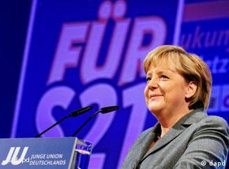 Chancellor Angela Merkel speaks to supporters