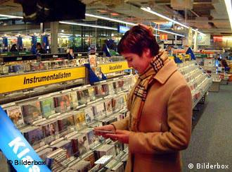 One woman looking at a CD in an otherwise empty store