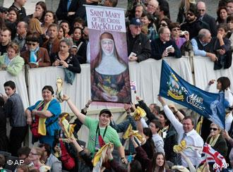 Faithful hold a sign of Mary MacKillop