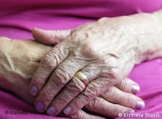 Picture of an elderly woman's crossed hands
